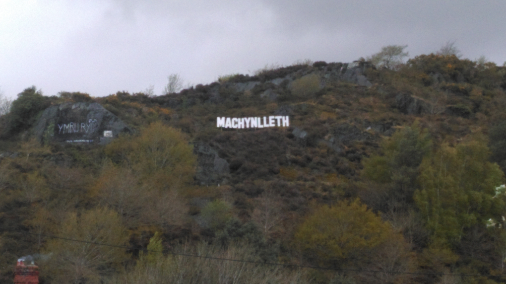 the sign which overlooks the town during the weekend of the Machynlleth Comedy Festival and the Dyfi Enduro