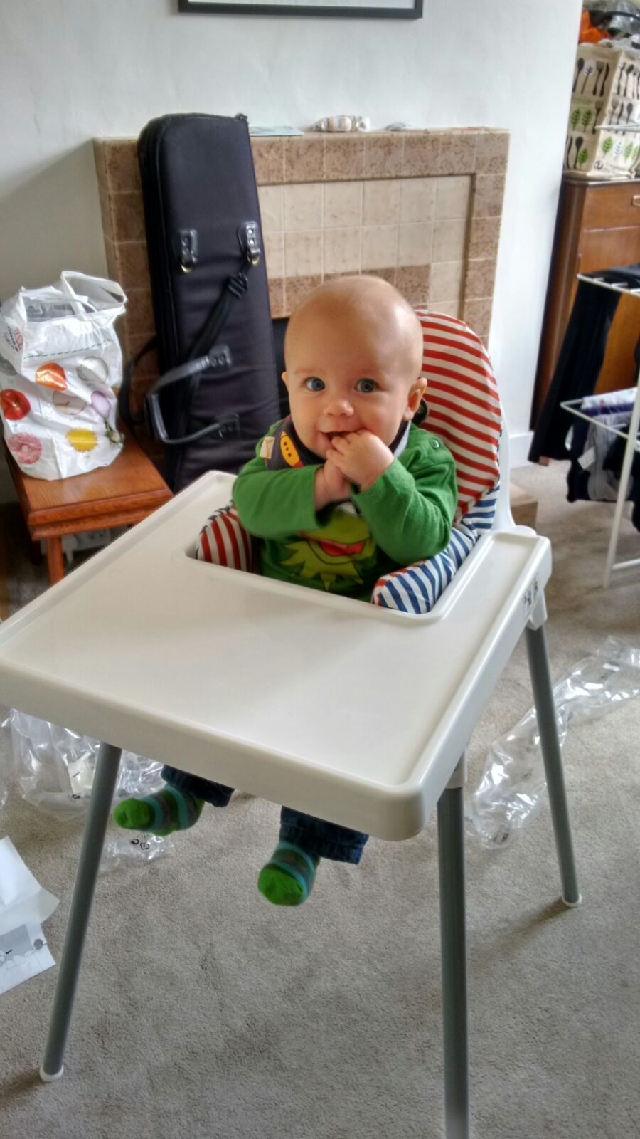 baby in a wipe clean chair