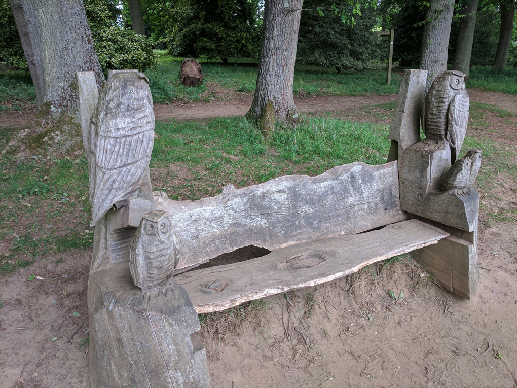 bench with carved owls