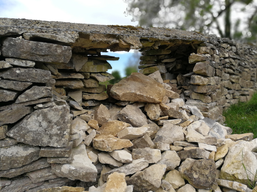 dry stone wall with a hole