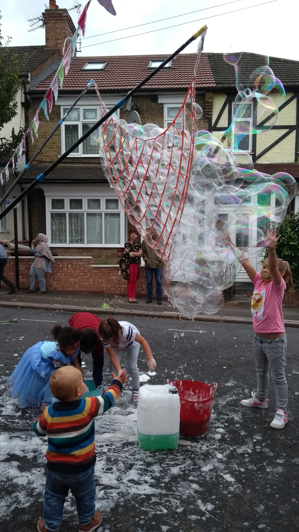 people playing with bubbles