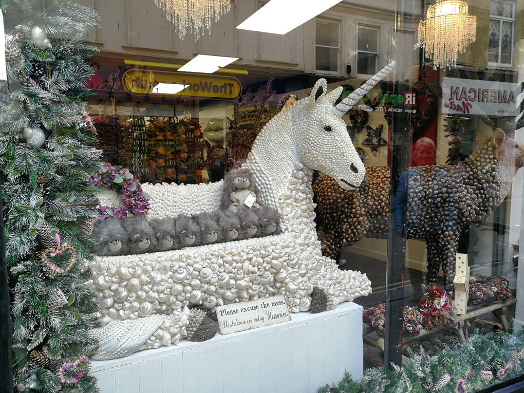 unicorn made of shells in a shop window
