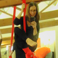 photo in a mirror while hanging from a silk