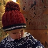 baby in a Christmas jumper