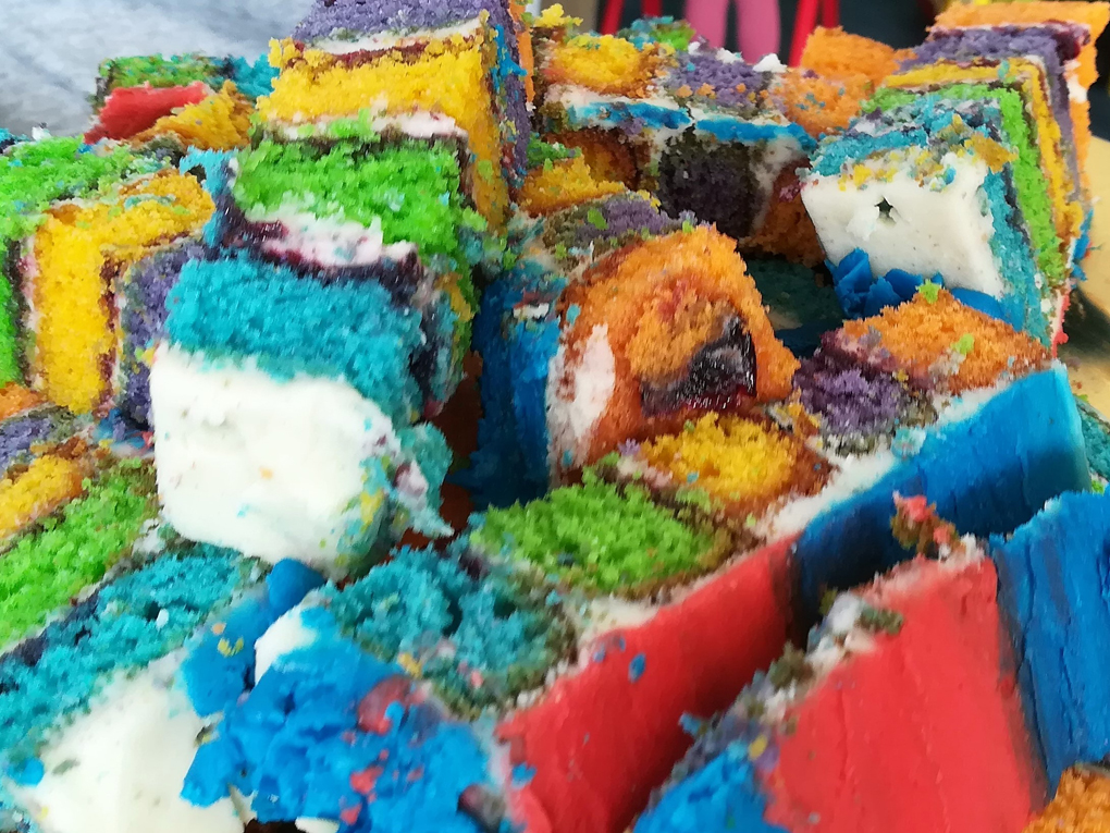 Slices of brightly coloured rainbow cake