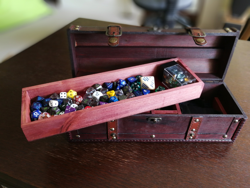 small chest filled with dice