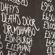 price list of gins in a pub