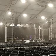 a large tent with empty seating and stage