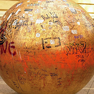 A bronze sphere, 2 metres in diameter, representing the sun and covered in grafitti.