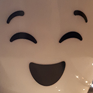 Coffee cup with smiling face