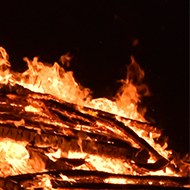 the heart of a bonfire with a wooden door refusing to burn