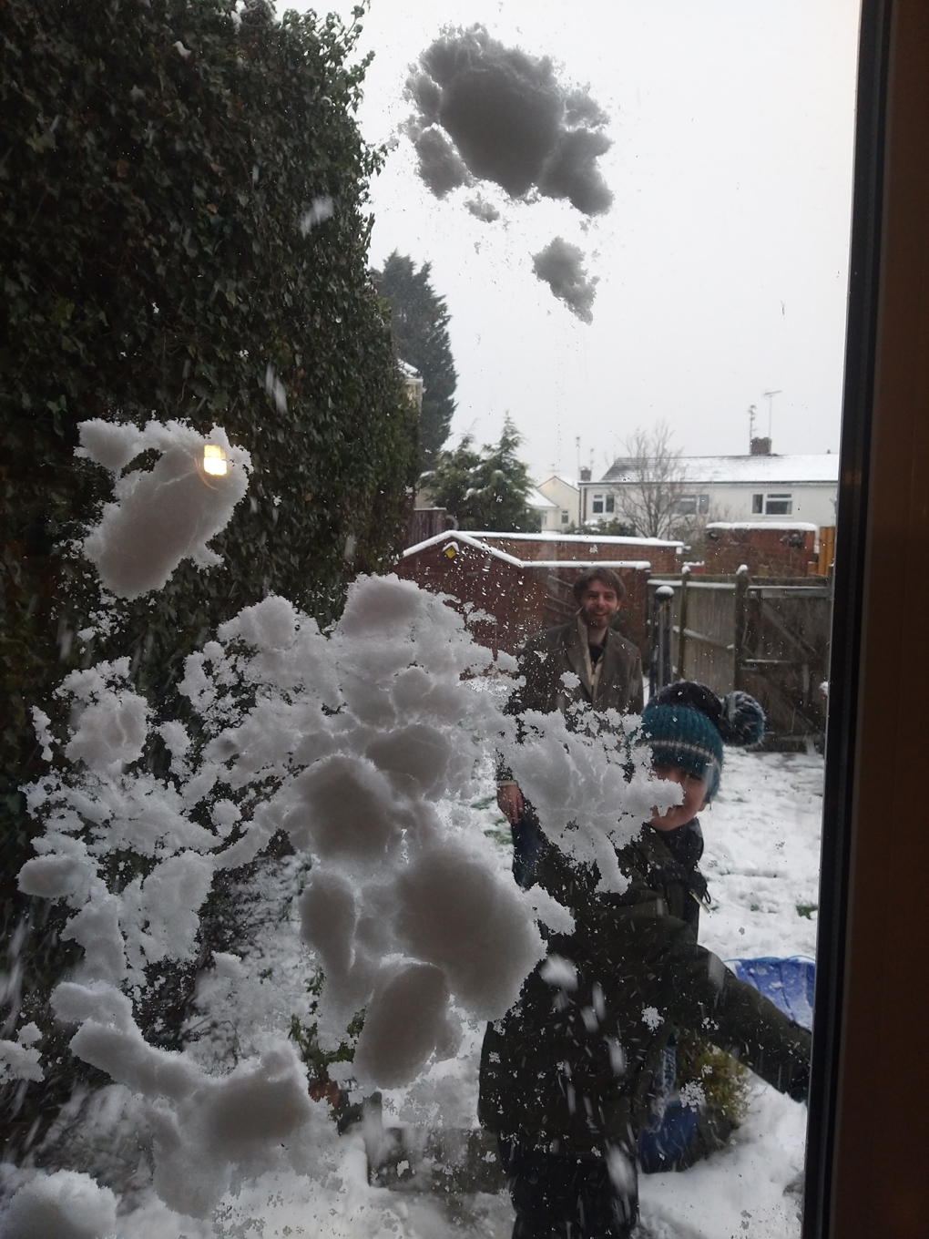 Snowball flattened across a window