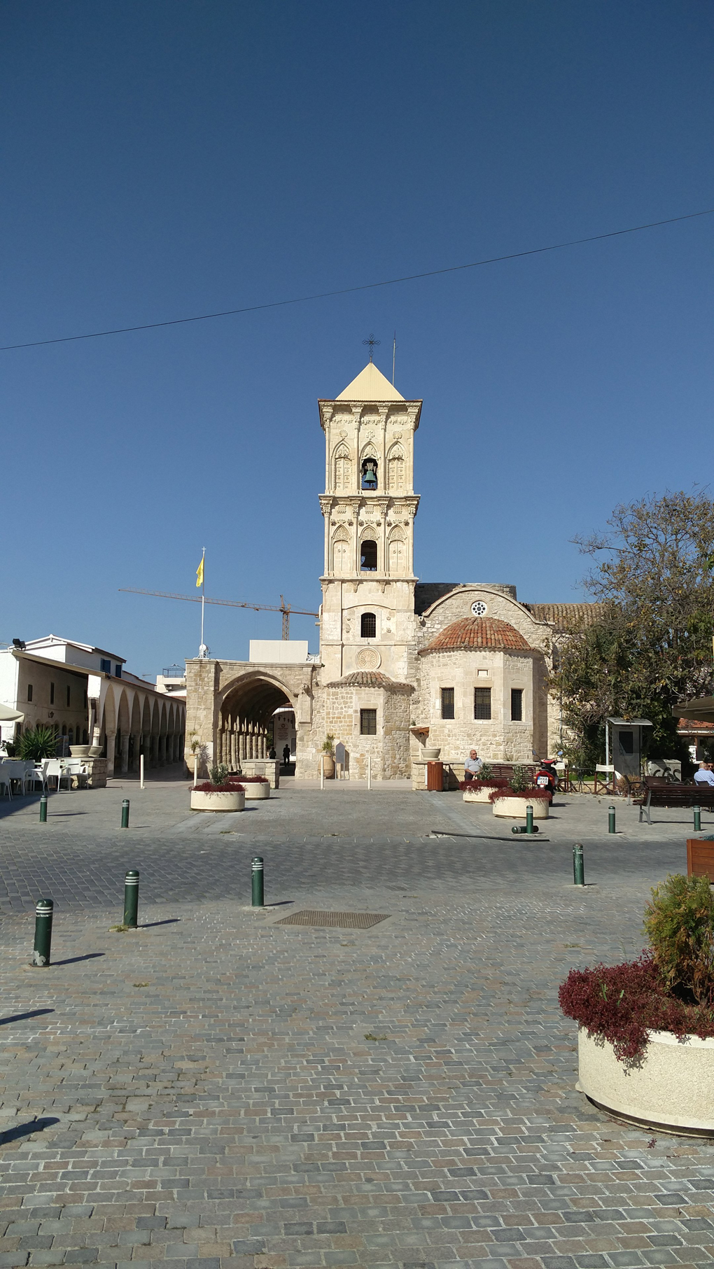 white church in a square in Cyprus
