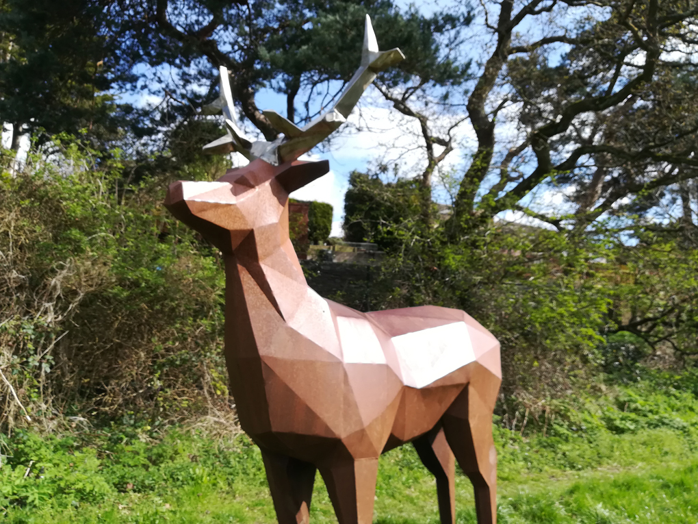 A statue of a deer, made of flat shapes
