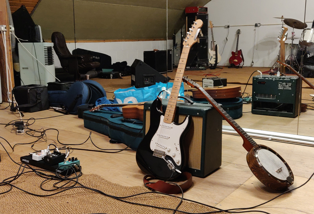 Guitars and amplifiers in a rehearsal studio