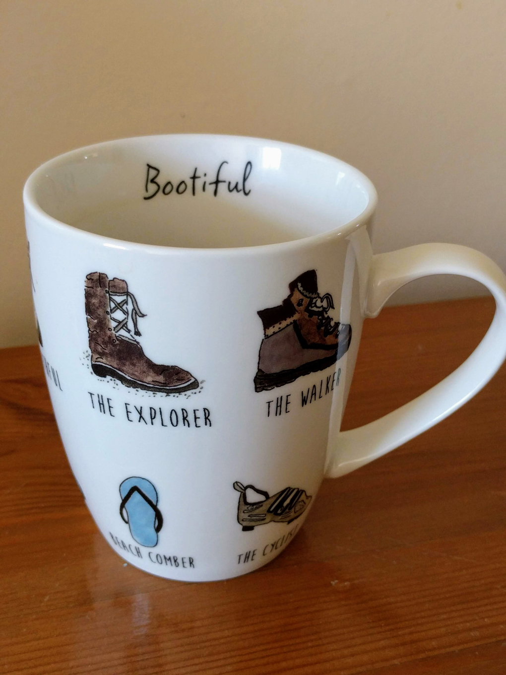 A mug with walking motifs found in a Walkers hotel.