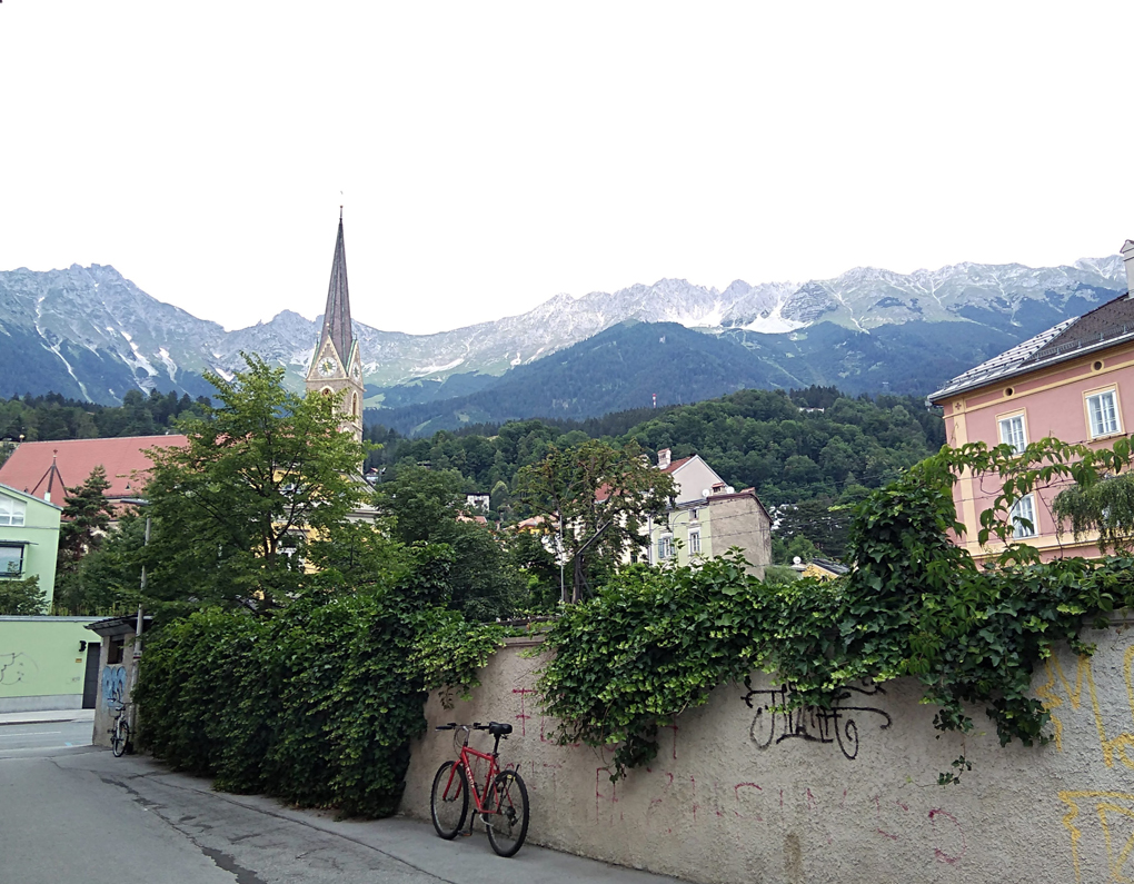 This picture shows a quiet residential area of Innsbruck backed by an impressive mountain range.