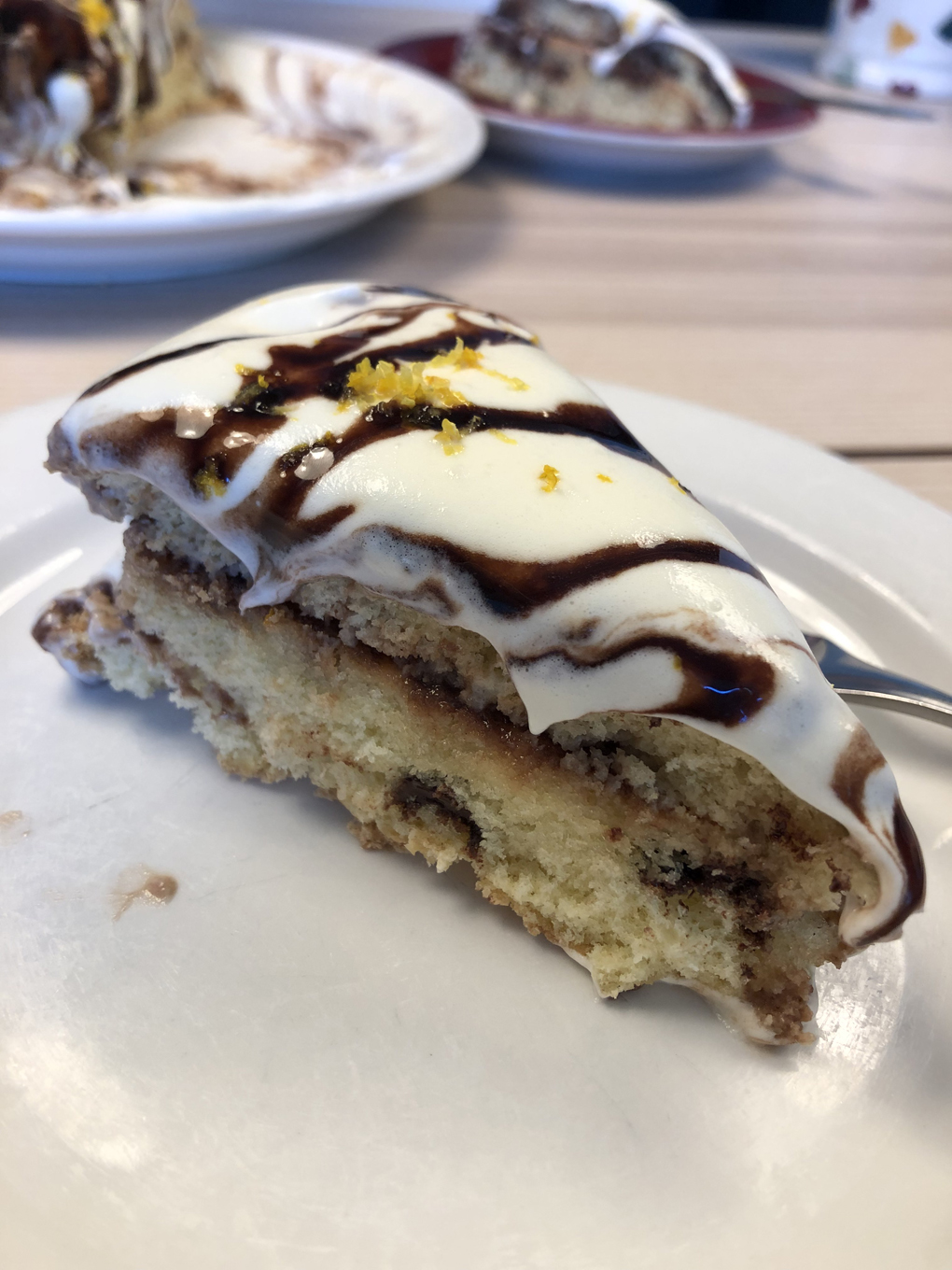 A slice of cake with creamy topping