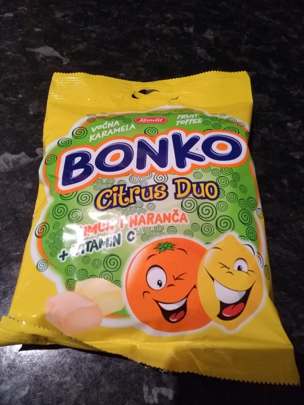 packet of sweets with cartoon lemon and orange on front