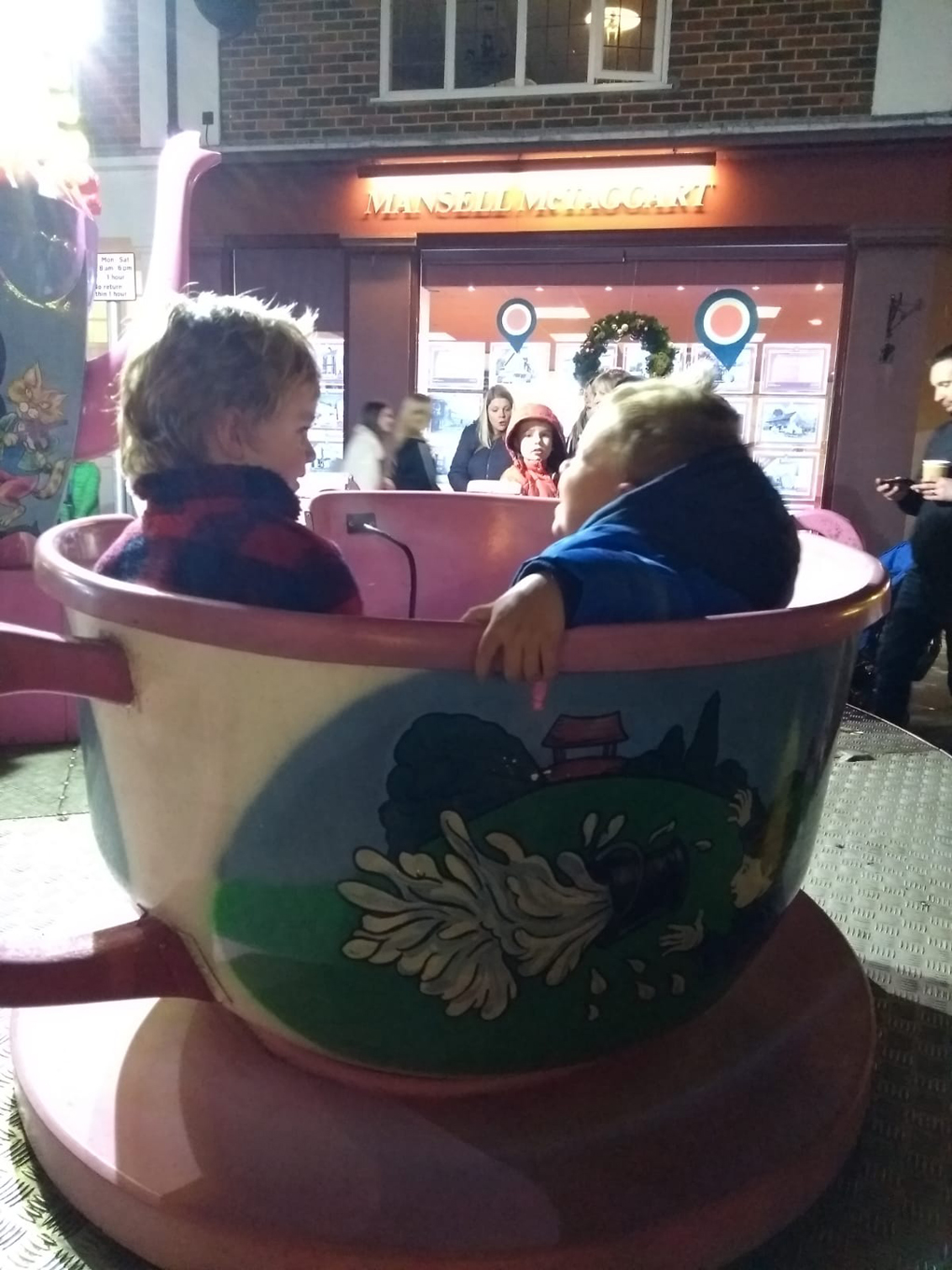 couple of boys on a teacup ride