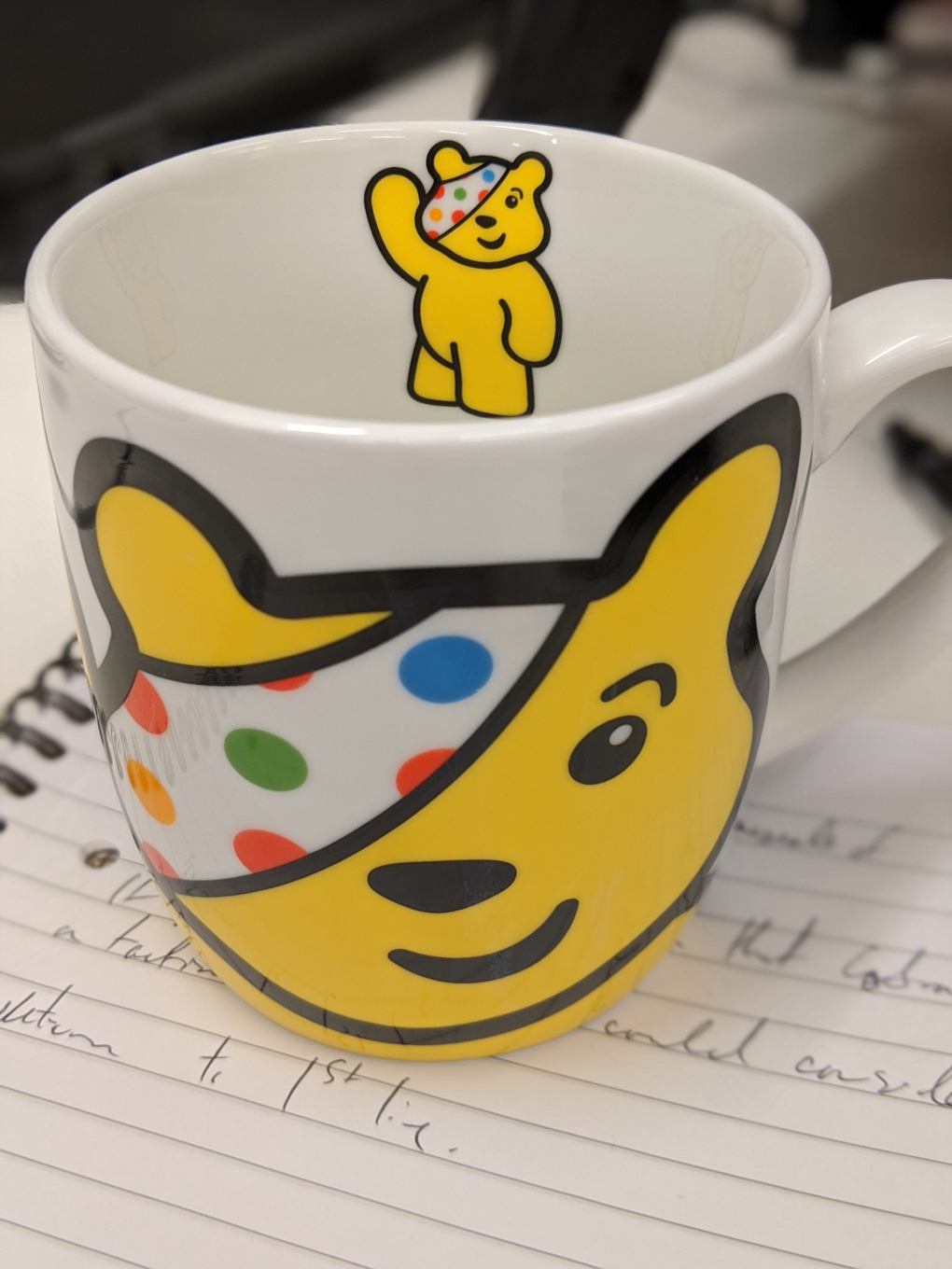 A photo of a mug decorated with a picture of pudsey the bear
