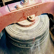 A large bell hung for full circle ringing in Minchinhampton church tower.