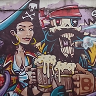 Very colourful street art depicting Captain Hook and his pirate mistress having a jar together. It makes a big splash on the side of an old pub called The Seven Stars, renown for having accommodated the Abolitionist Thomas Clerkson sometime in the 1800's to further his research for the anti-slave trade campaign.
