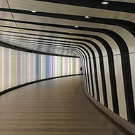curved tunnel with walls lit up in various colours