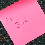 A pink post it note with the words For Jane written on it