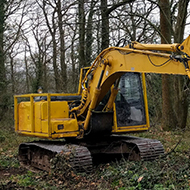A yellow logging crane in a forest in Herefordshire.