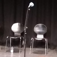 seats on a stage at a recording