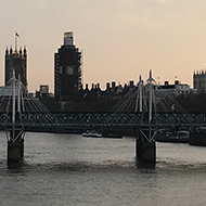 A view from Waterloo Bridge of the London Eye and the Palace of Westminster in the background