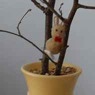 hazel branch decorated with eggs,bunnies and chicks nests
