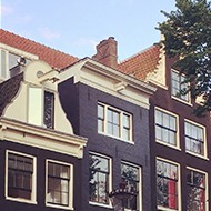 A row of narrow houses in Amsterdam overlooking a canal