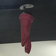 glove over a fire extinguisher in the roof