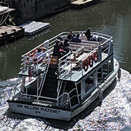 A double-decker passenger boat makes it way down the river in Bath