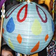 Children and adults with colourful paper lanterns