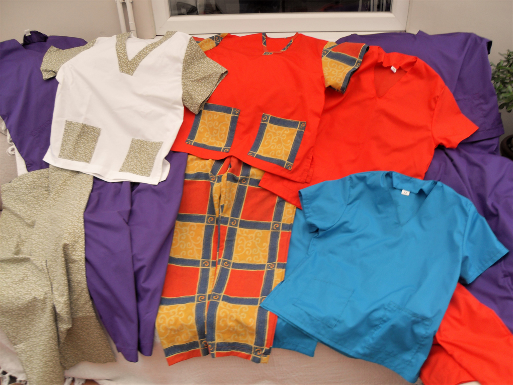 6 sets of hospital scrubs in different colours