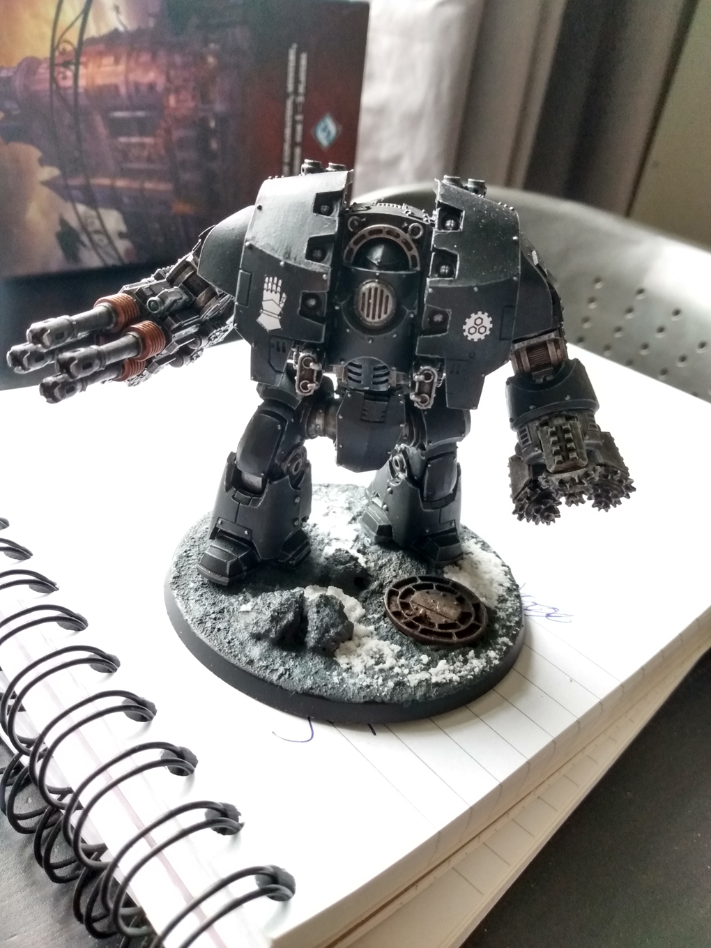 A warhammer miniature painted in the black of the Iron Hands legion