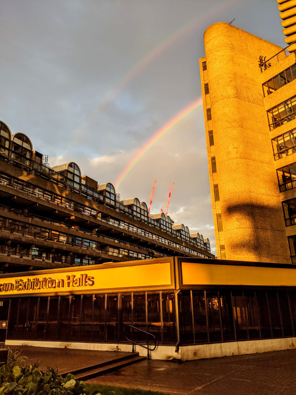 Double rainbow over Barbican exhibition and apartment buildings in central London