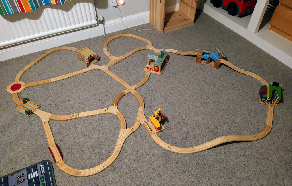 wooden trainset on carpet