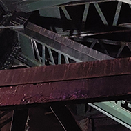 Looking up into the criss cross of structural steel supporting the Tyne Bridge in Newcastle