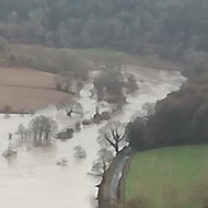 Flooded River with Bigsweir Bridge just holding on.