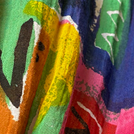 Close-up of fabric showing multicoloured letters