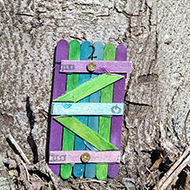 small model door in a tree