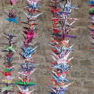 1000 paper birds hung on strings.