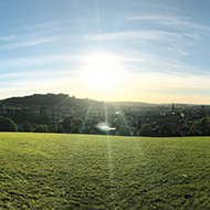 View of Bath bathed in sun light from Bathwick Hill.